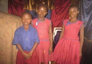 Sarah Koroma, age 11, on far right; Kadiatu Koroma, age 9, in the middle; and Emmanuel Koroma, age 8, on far left.