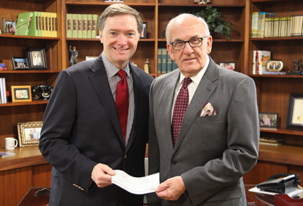 Clements Presents Check to Church of God for Relief Efforts